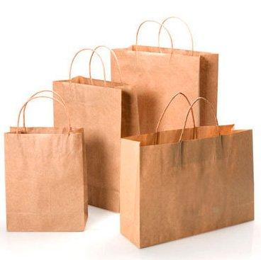 cuatro bolsas de papel kraft